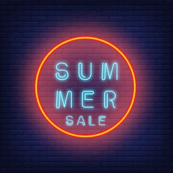 Summer sale neon text in circle. seasonal offer or sale advertisement