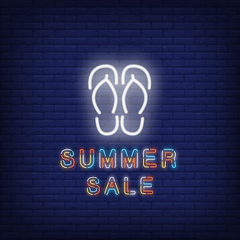 Summer sale neon text with flip-flops. seasonal offer or sale advertisement