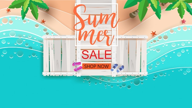 Summer sale with beach scene from the top