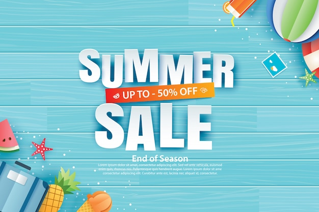 Summer sale with decoration origami on blue wooden background.