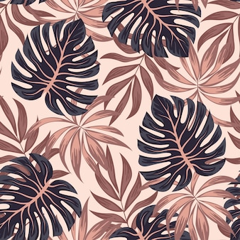 Summer seamless tropical pattern with bright leaves and plants on a beige background