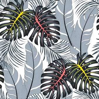 Summer seamless tropical pattern with bright leaves and plants on a white background