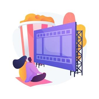 サマーシアター。夏のエンターテインメント、映画鑑賞、アウトドアレクリエーション。野外映画館でリラックスした夜を楽しんでいるカップル、ロマンチックなデートのアイデア。