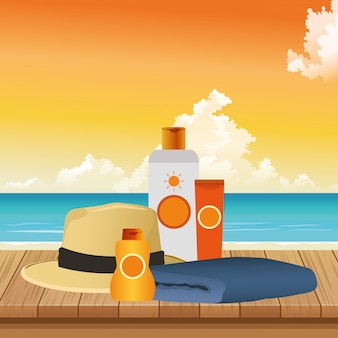 Summer time in beach vacations sunblock bottle cream hat and towel
