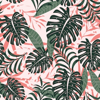 Summer trend seamless background with bright tropical leaves and plants