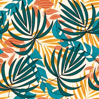 Summer trend seamless pattern with bright tropical leaves and plants