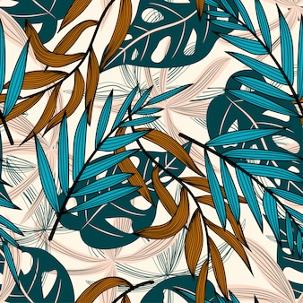 Summer trend seamless pattern with colorful tropical leaves and flowers