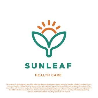 太陽と2つの葉のシンボルアイコン病院の診療所と薬局のヘルスケアのロゴ