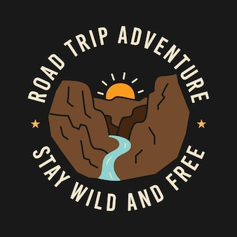Sun rising over mountains with river amidst road trip adventure and stay wild and free inscriptions on t shirt design