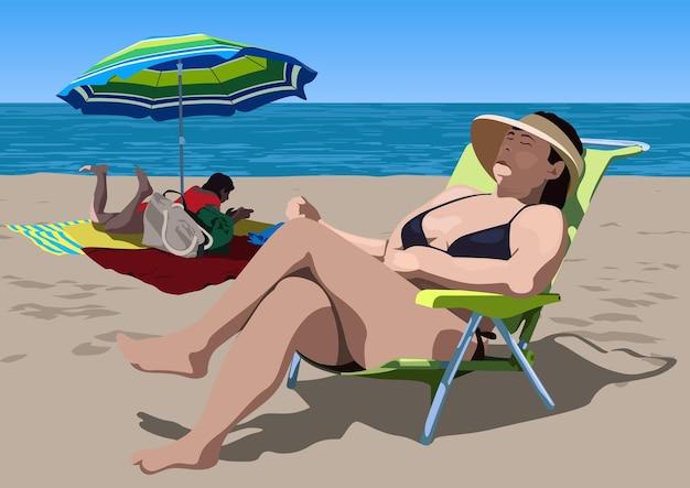 Sunbathing people on the sandy beach