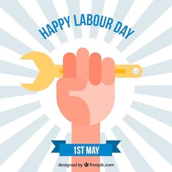 労働日のための手とツールによる日の出の背景