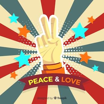 日の出の手の平和サイン