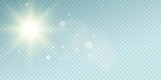 青い透明な背景にサンバースト。まぶしさのある透明な太陽光線。抽象的なライトボケと太陽 Premiumベクター