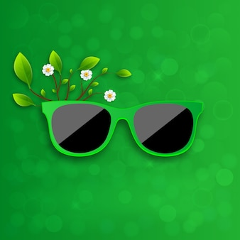 Sunglasses in green background.