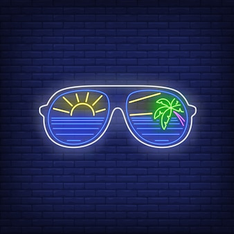 Sunglasses with sea, sun and palm tree reflection neon sign