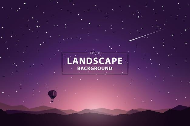 山の景色と熱気球の日の出