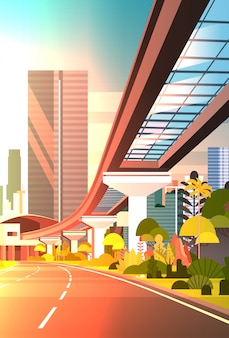 Sunset cityscape with skyscrapers and railway road modern city view