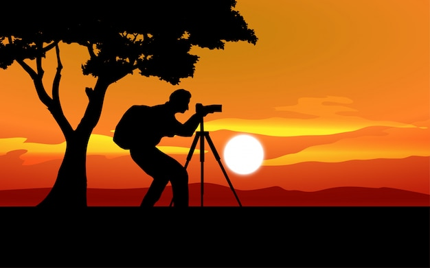 Sunset landscape with photographer silhouette