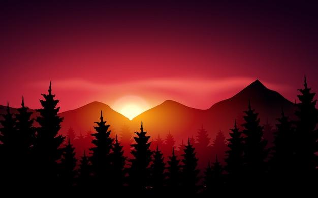 松の森と山に沈む夕日