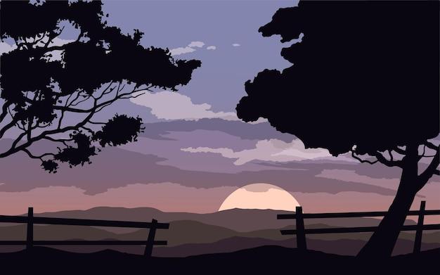 나무와 울타리 일몰 장면