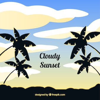 Sunset with clouds and plam trees background in flat style