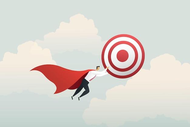 하늘의 성공 목표를 향해 날아가는 목표물을 들고 있는 슈퍼 영웅 사업가