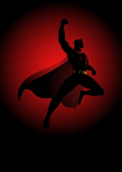 Superhero flying on dramatic red background