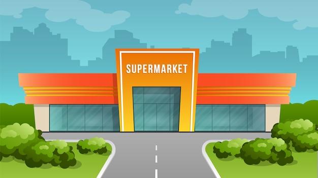 Здание супермаркета на фоне города