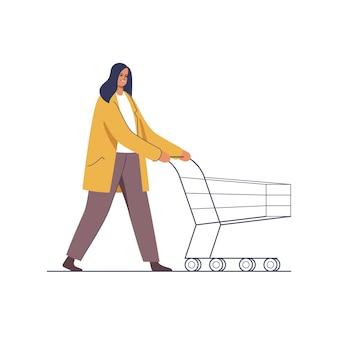Супермаркет за покупками женщина делает покупки на праздники, толкая тележку для покупок