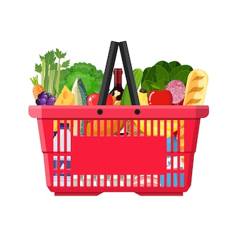 Supermarket shopping basket full of groceries products. grocery store.