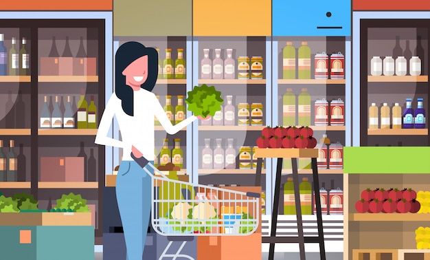Supermarket woman customer with shopping trolley cart
