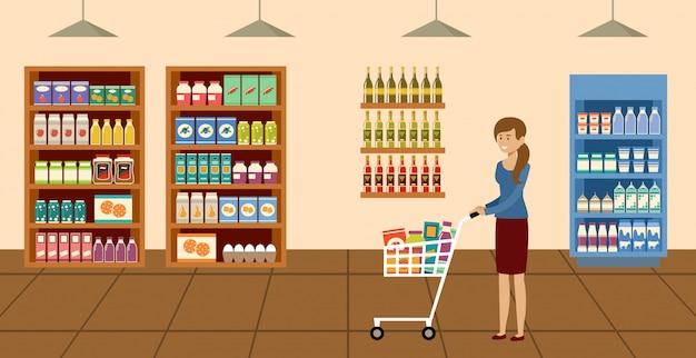 Супермаркет. женщина с корзиной выбора и покупки продуктов в продуктовом магазине