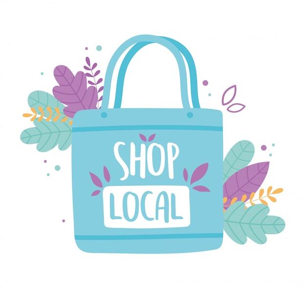 地元のビジネスをサポートし、葉のある小さな市場のエコバッグを買う