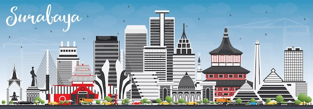 회색 건물과 푸른 하늘 수 라바 야 스카이 라인.
