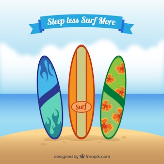 Surfboards on the beach with a quote