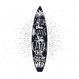 Surfing related summer typography poster in monochrome vintage style. catch the wave, catch the summer - lettering inside the surfboard