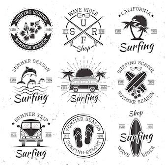 Surfing set of nine black vector emblems, badges, logos in vintage style