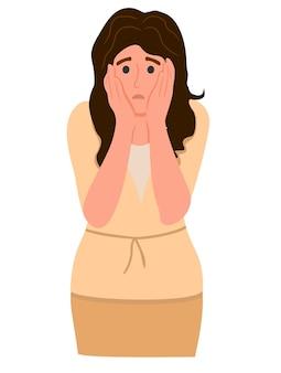 パニックに頭を抱えて怖い表情で驚いてショックを受けた女性