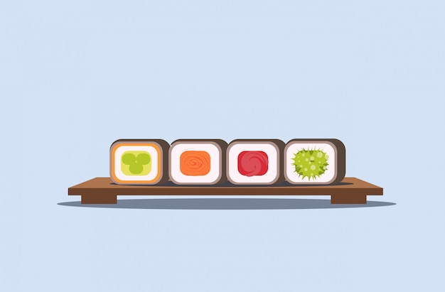 Sushi set rolls on wooden board traditional japanese kitchen concept  horizontal