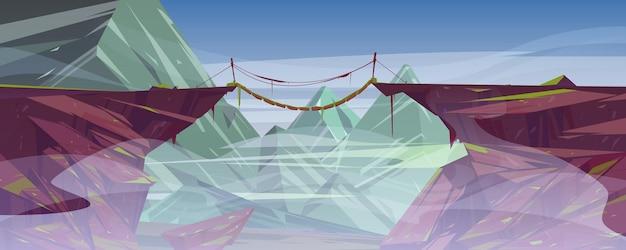 안개가 자욱한 산 절벽 위에 매달린 로프 다리