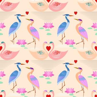 Swan in love swim in the water with heart shape pattern.