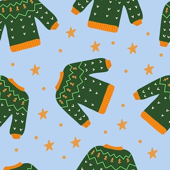 Sweater seamless pattern on a blue background. green, yellow, blue colors. autumn and winter collection. vector hand drawn illustration.