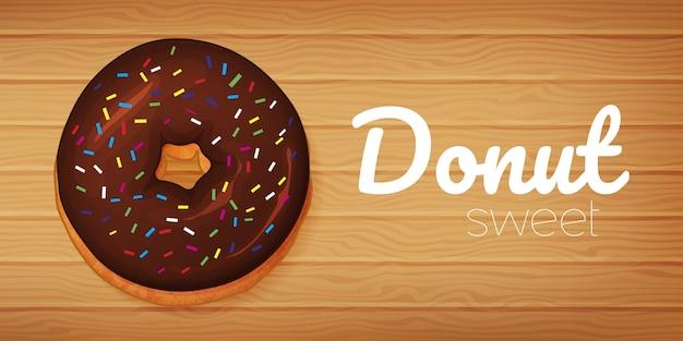 木材の背景に甘いチョコレートドーナツ。水平チラシ。