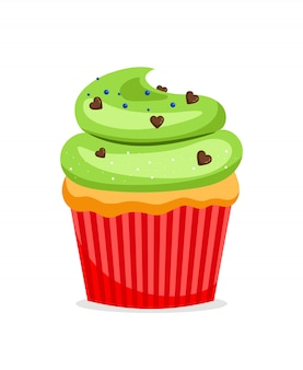 Sweet cupcake or muffin with green frosting and chocolate heart sprinkles