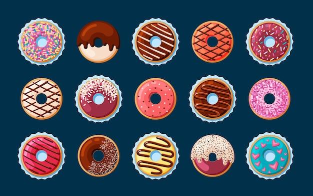 Сладкие пончики с набором декоративной глазури. красочная выпечка с кремом, посыпанным розовой и шоколадной пудрой, праздничное угощение с авторским индивидуальным ажурным оформлением праздника. вектор вкуснятина.