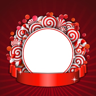 Сладкая рамка из красных и белых конфет с красной лентой