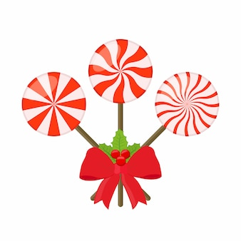 Sweet lollipops with red ribbon and holly