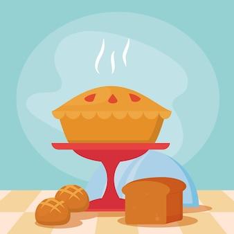 青い背景の上の甘いパイとパン