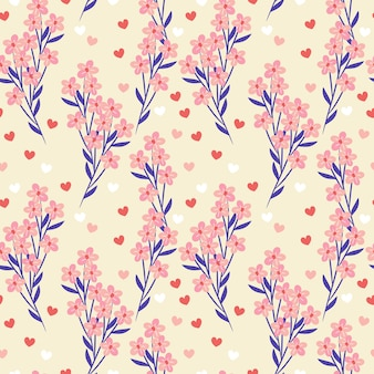 甘いピンクの花と小さな心の背景。