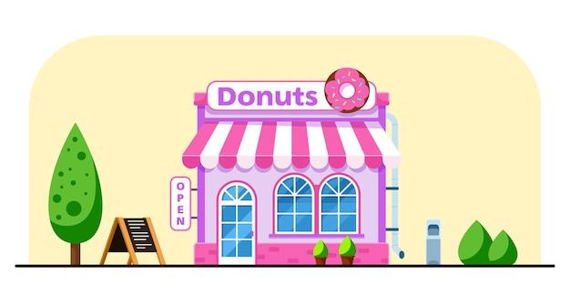 Дизайн здания магазина сладостей с большим пончиком в плоском стиле